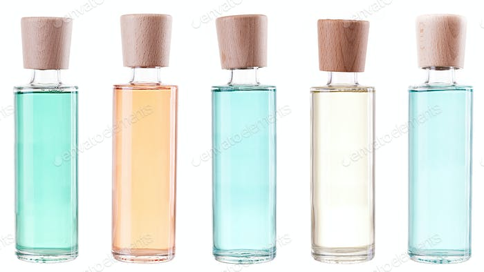 Colored bottles with perfumes isolated on white