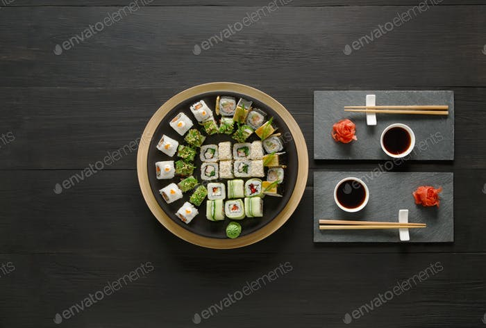 Thumbnail for Set of sushi maki and rolls at black rustic wood.