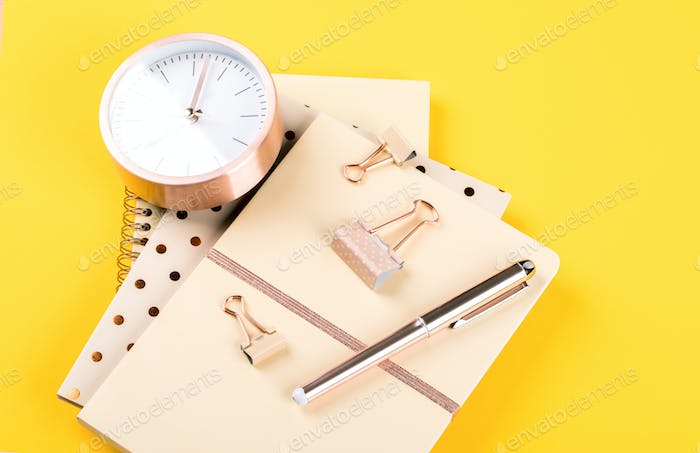 Notebook ,pen and alarm clock .Accessories office concept