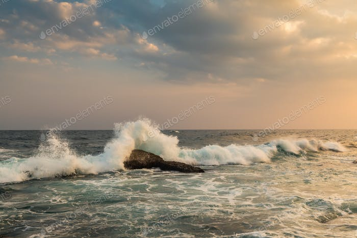 Storm waves in sunset at a tropical resort