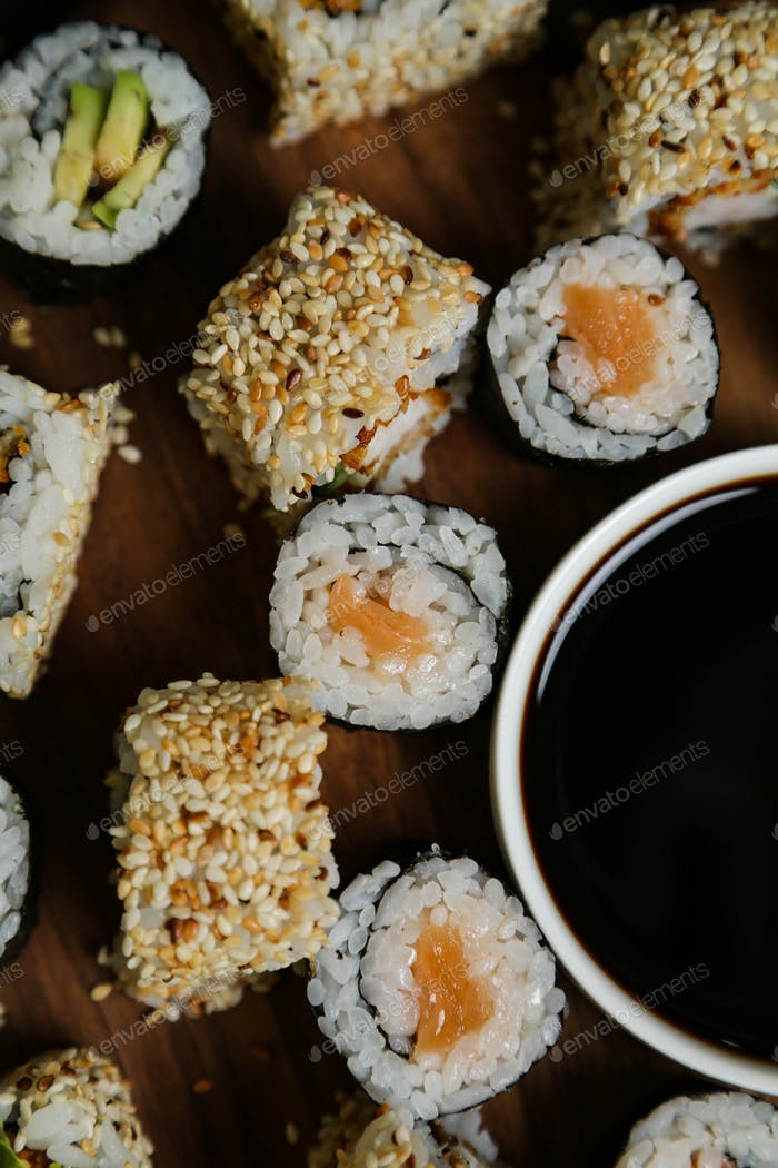 salmon roll ginger soya sesame wasabi top view