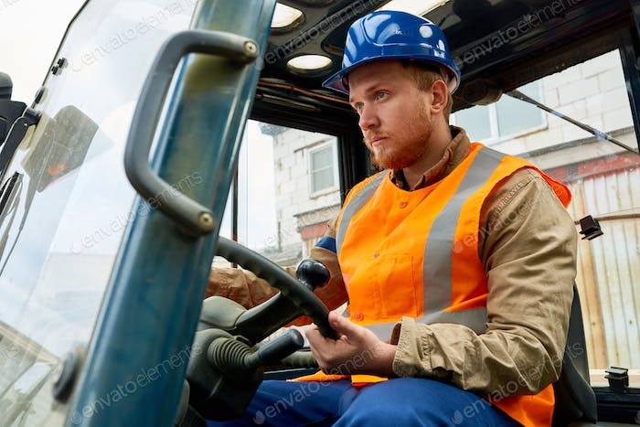 Bearded Worker Driving Lift Truck