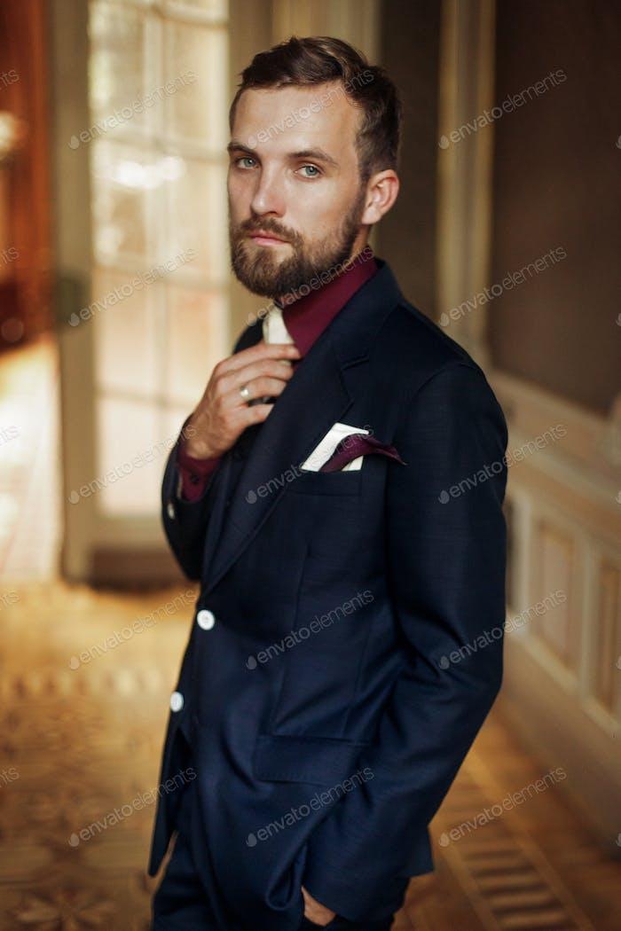 stylish handsome groom posing