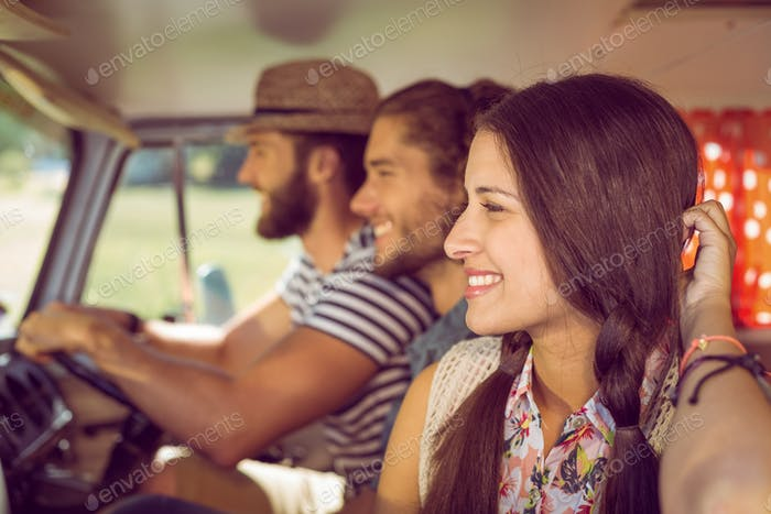 Hipster friends on road trip on a summers day