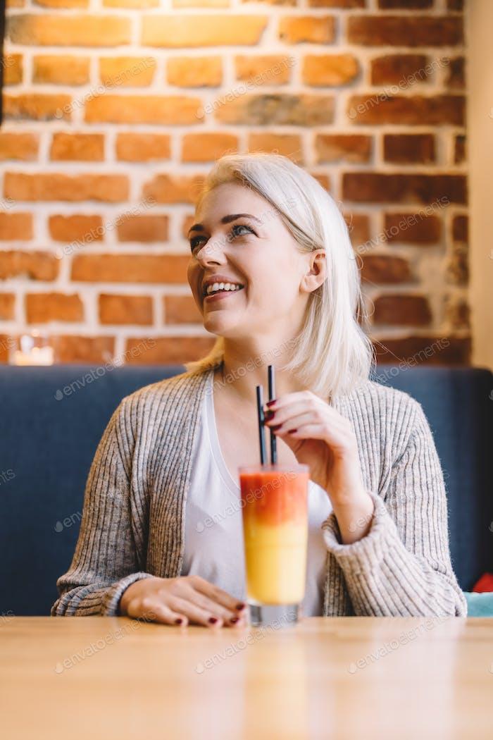 Woman drinking healthy refreshing juice.