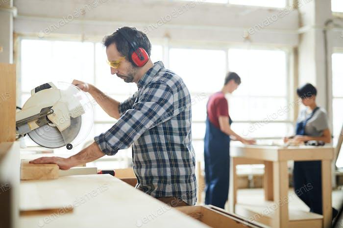Using circular saw in workshop