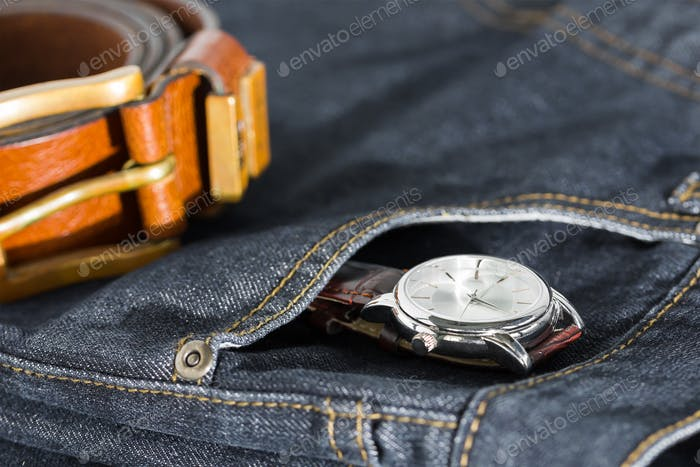 Wrist watch and leather belt on jeans-5