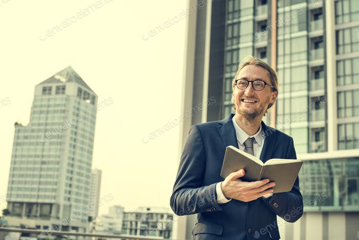 Businessman Working Reading Book Concept