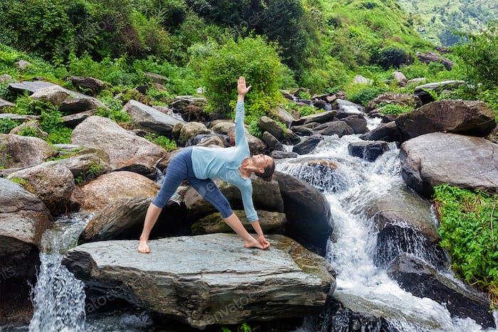 Woman doing Ashtanga Vinyasa yoga asana  outdoor