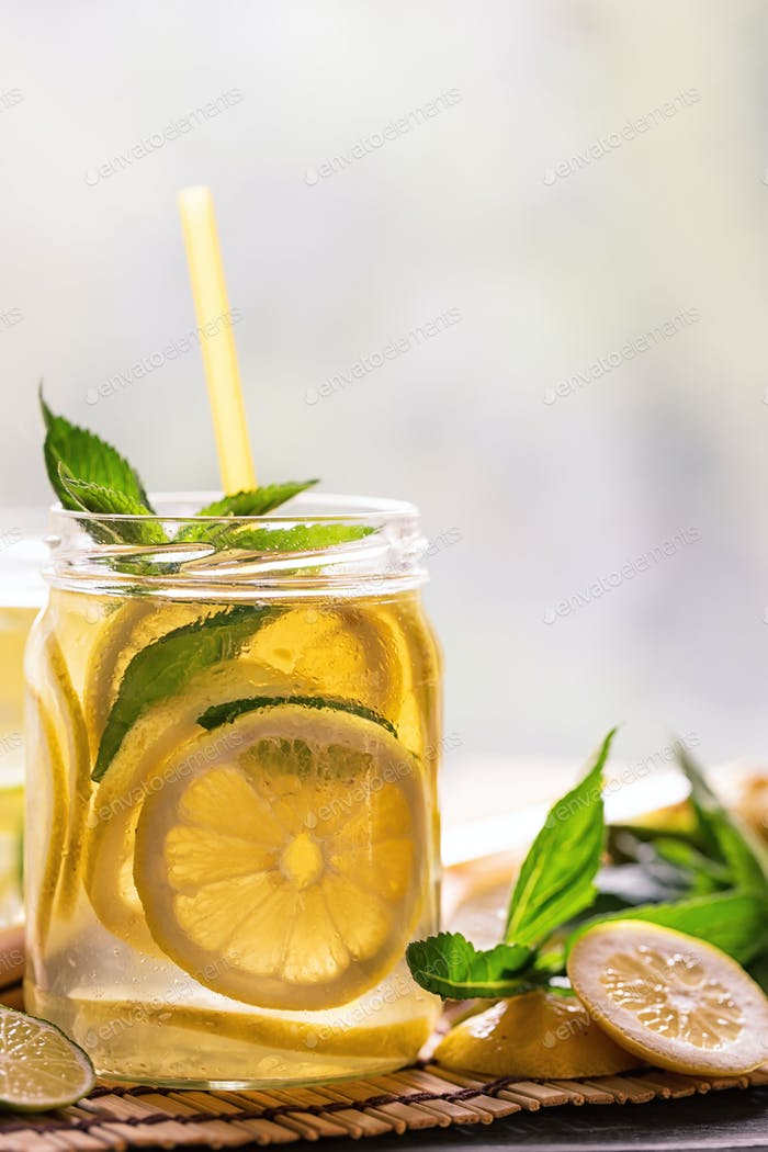 Bank lemonade with straw and mint leaves