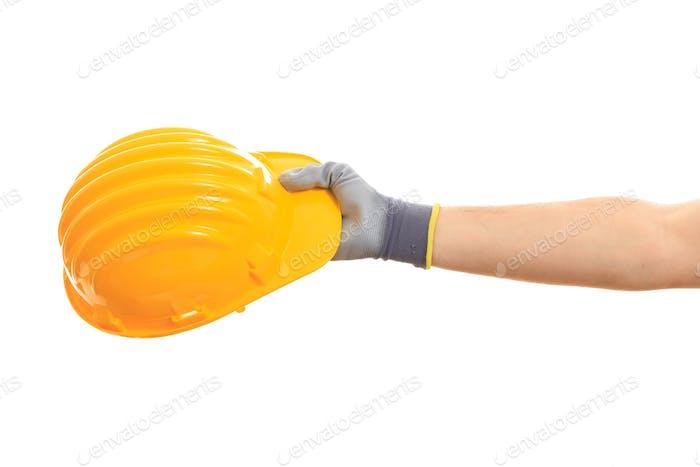 Gesundheit und Sicherheit. Hand hält einen harten Hut auf weißem Hintergrund