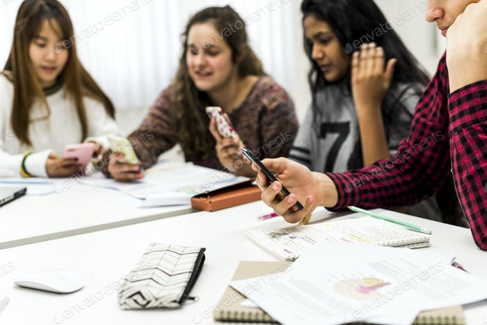 Highschool student using a smartphone in a class