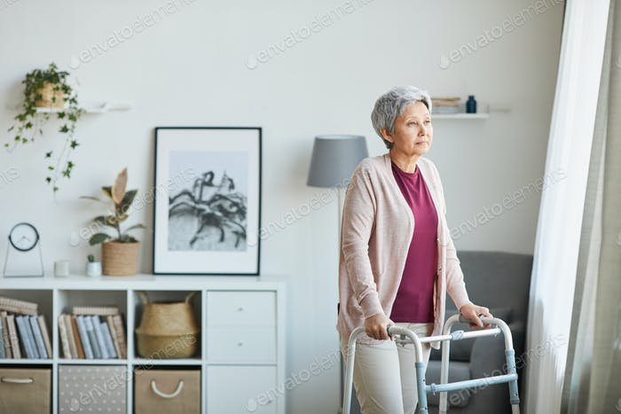 Senior woman with walker at home
