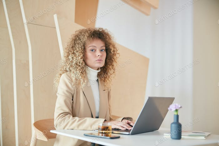 Portrait of Modern Young Businesswoman in Cafe