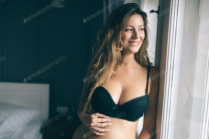Fashion photo of beautiful girl posing in sexy black underwear