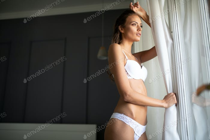 Sensual brunette woman with glamorous face in white lingerie