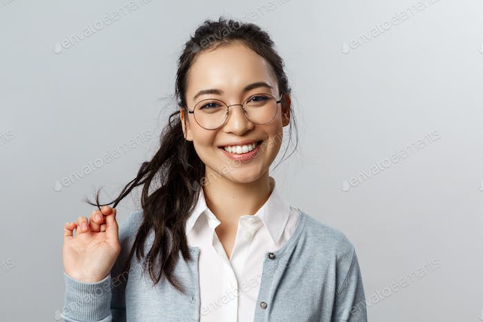 Close-up portrait of flirty, enthusiastic brunette asian female in glasses, beaming smile, roll