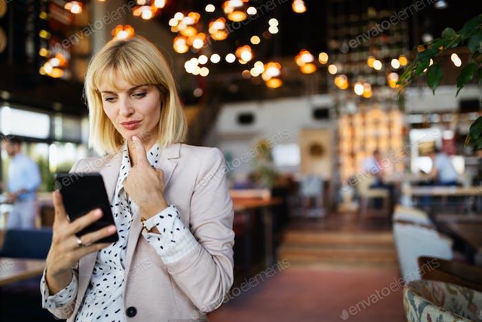 Beautiful brunette coworker businesswoman talking on mobile phone