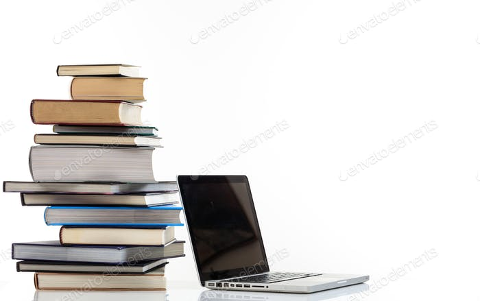 Books stack and a laptop on white background