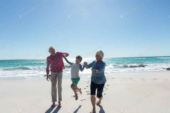 Grandparents and grandson at the beach