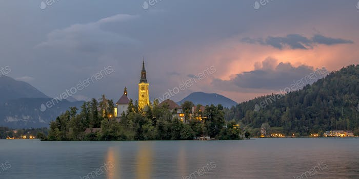 Lake bled with church under storm
