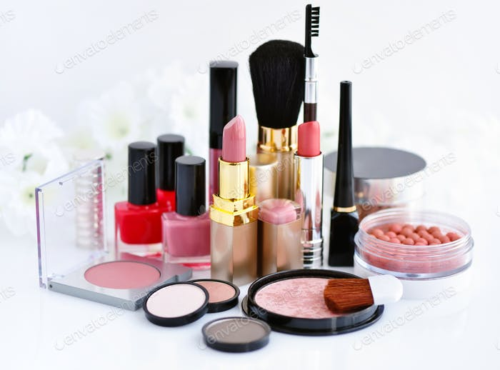 Set of decorative cosmetic: powder, lipsticks, brush, blush, eye