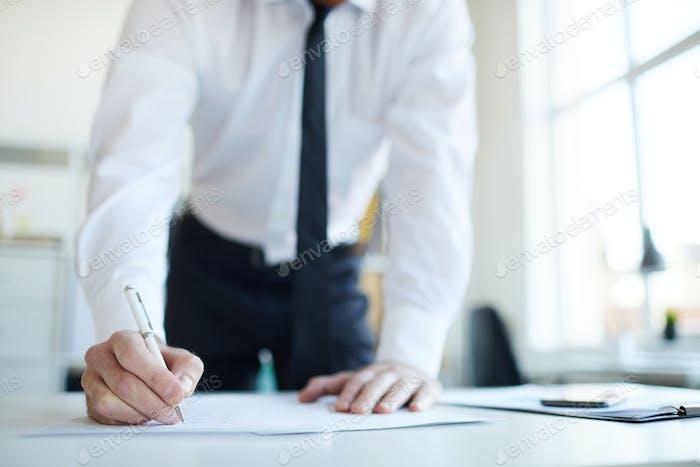 Putting signature on paper