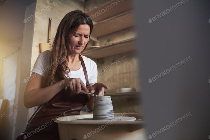 Female artisan getting creative in her pottery studio