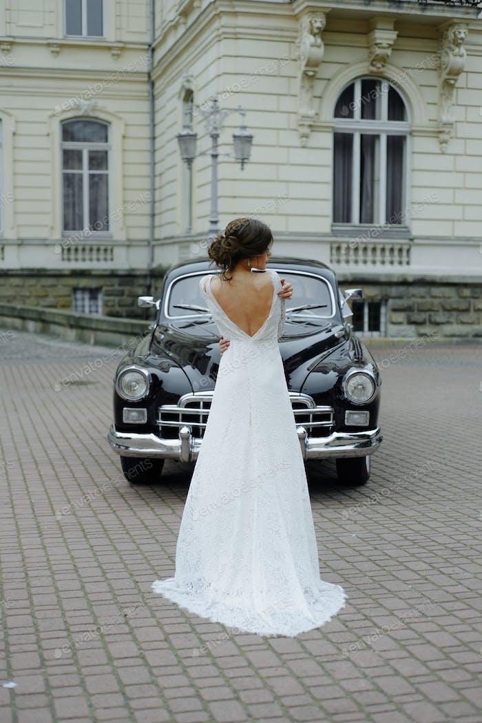 wedding couple with wedding car