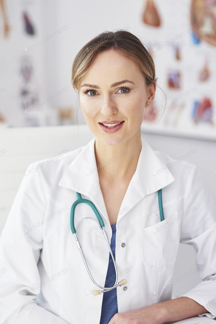 Portrait of smiling female doctor in her doctor's office
