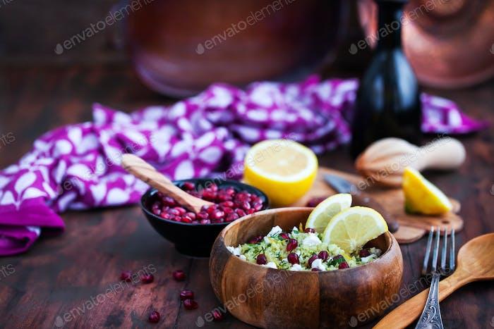 Delicious healthy cous cous salad with herbs, lemon zest, feta c