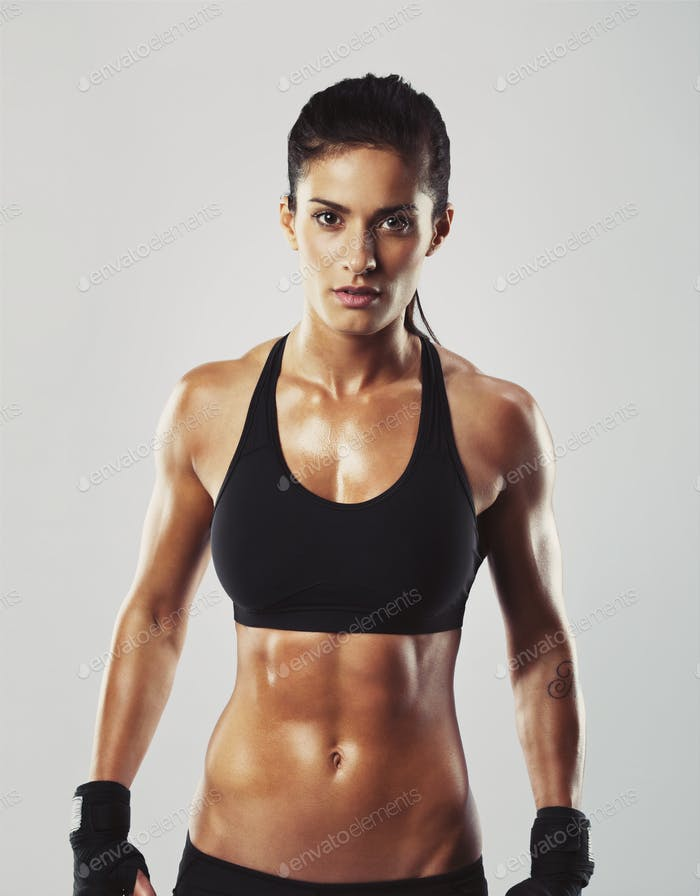 Fitness female posing confidently