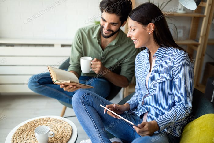 Couple is deciding if a book or ebook is better