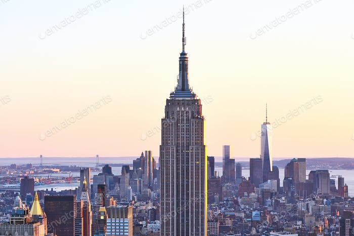 Cityscape view of Manhattan with Empire State Building at sunset