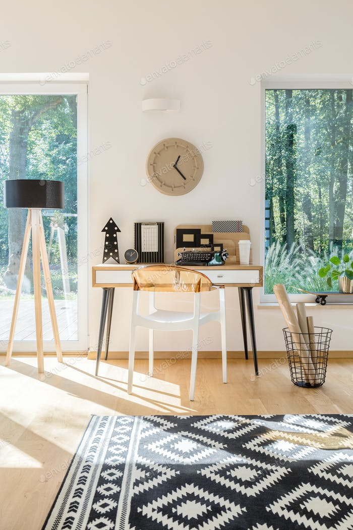 Scandinavian style workspace with clock