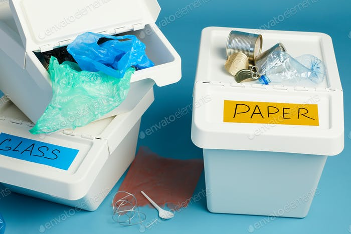 Plastic Trash Bins on Blue