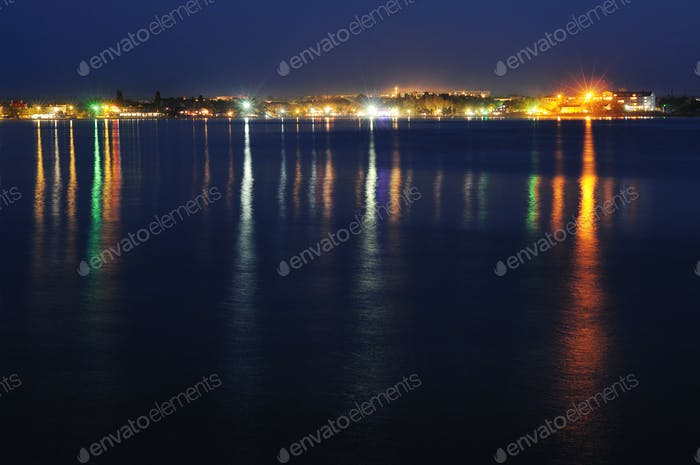 Night coastline, view from the pier of sea port