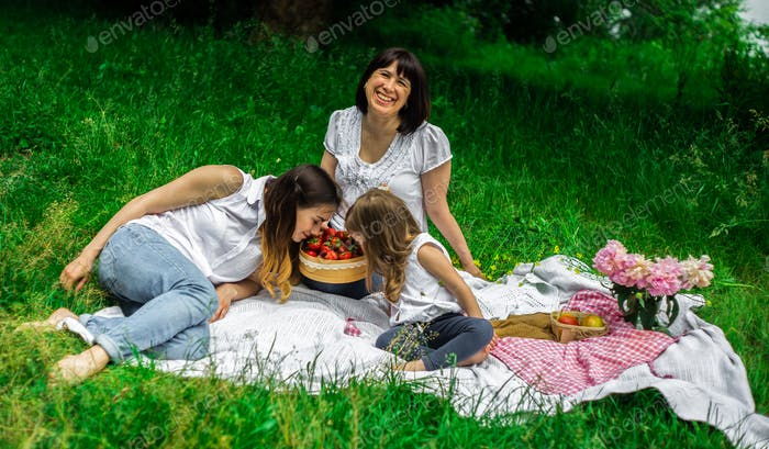 grandmother, daughter and granddaughter on a picnic