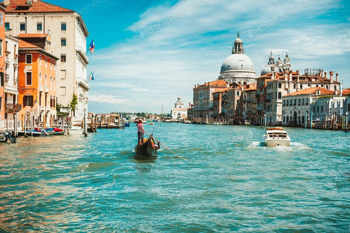 Venice, Italy. Gondolier looking for next tourists on Grand Canal. Basilica Santa Maria della Salute