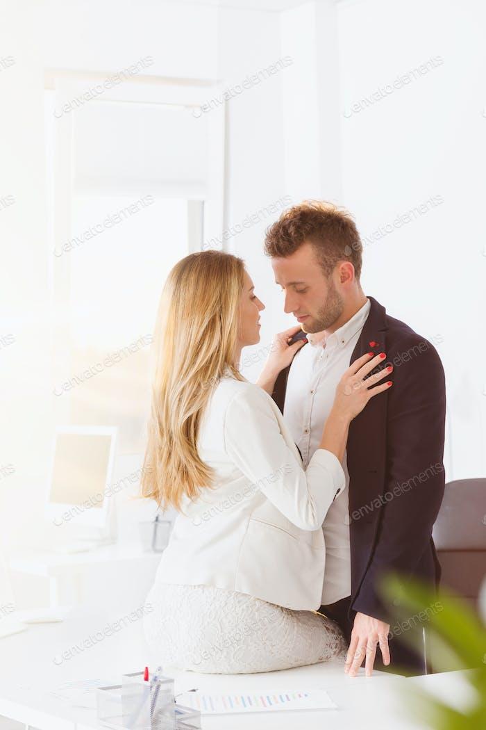 Couple having an affair at work