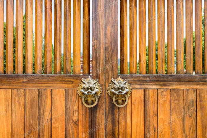 traditional style wooden doors and door knocker