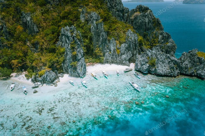 El Nido, Palawan, Philippines. Aerial view of tropical Island with tourist boats moored at white