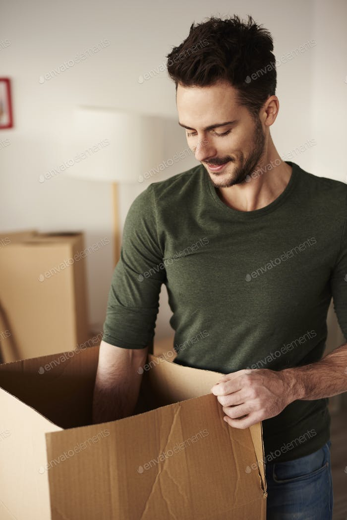 Man taking his stuff out from the cardboard box