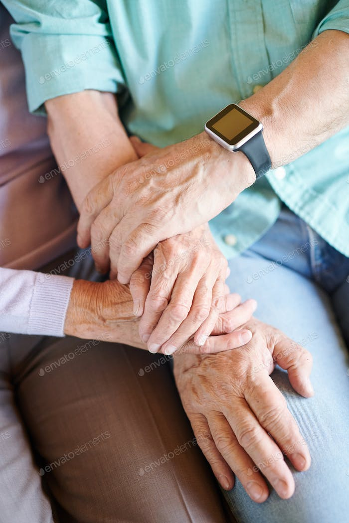 Overview of hands of retired spouses in casualwear