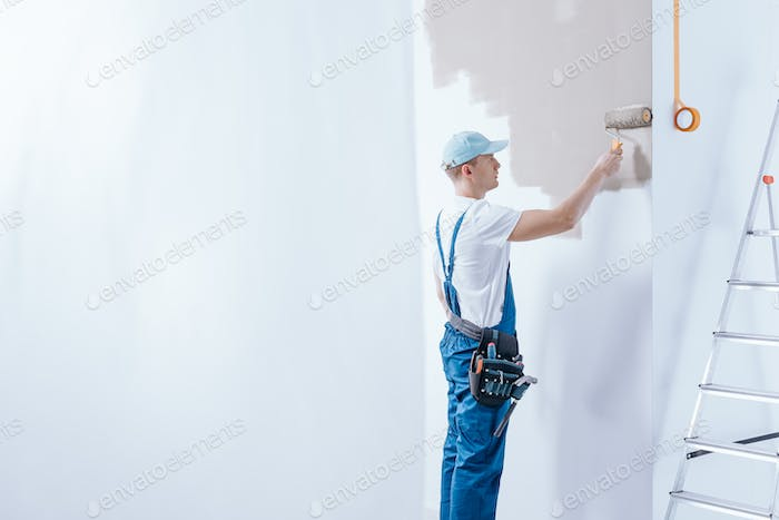 Painter in blue overalls