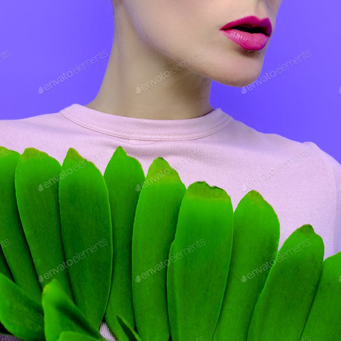 Sensual model with  green leaf. Fashion Concept. Cosmetics. Care