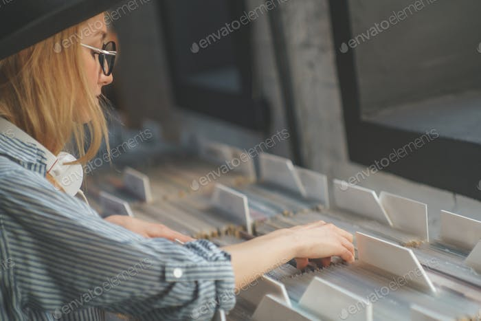 Young girl browsing records in the store