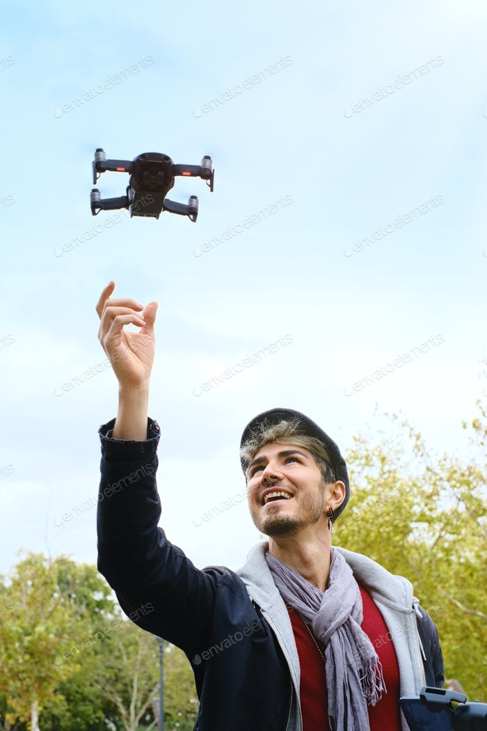 Young Man Flying Drone