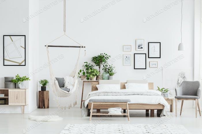 Bright bedroom interior with hammock