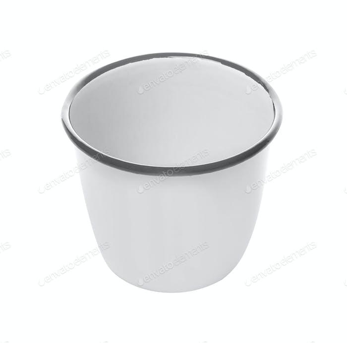 white enamel mug isolated on white background